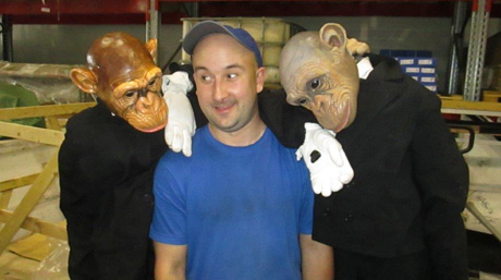 DSV warehouse employee surrounded by theatre characters - in monkey suits